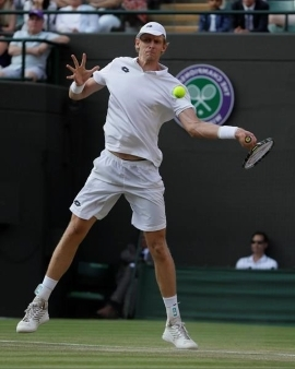 a man is swinging a racket at a ball