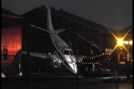 A plane is brought to a hangar after making an emergency landing at the Peterborough Airport on Sunday night.