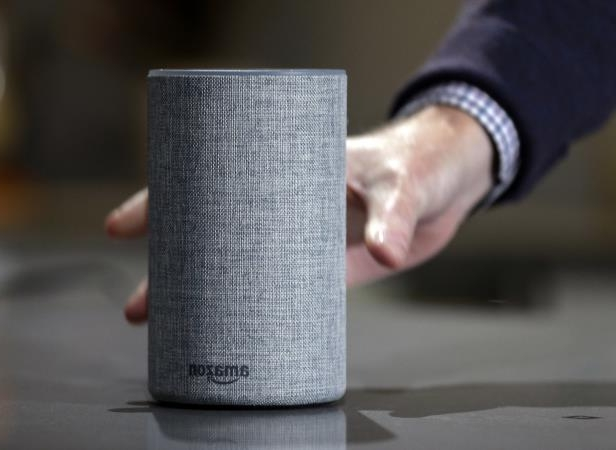FILE - In this Sept. 27, 2017, file photo, a new Amazon Echo is displayed during a program announcing several new Amazon products by the company, in Seattle. Amazon has launched a version of Alexa for hotels that lets guests order room service through the voice assistant, ask for more towels or get restaurant recommendations without having to pick up the phone and call the front desk. Marriott signed up for the service. (AP Photo/Elaine Thompson, File)