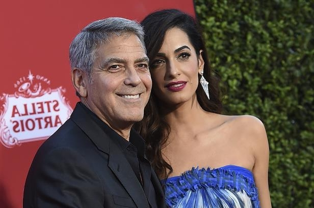George Clooney is 'hospitalised after crashing his motorbike and smashing into a car's windscreen in Sardinia'