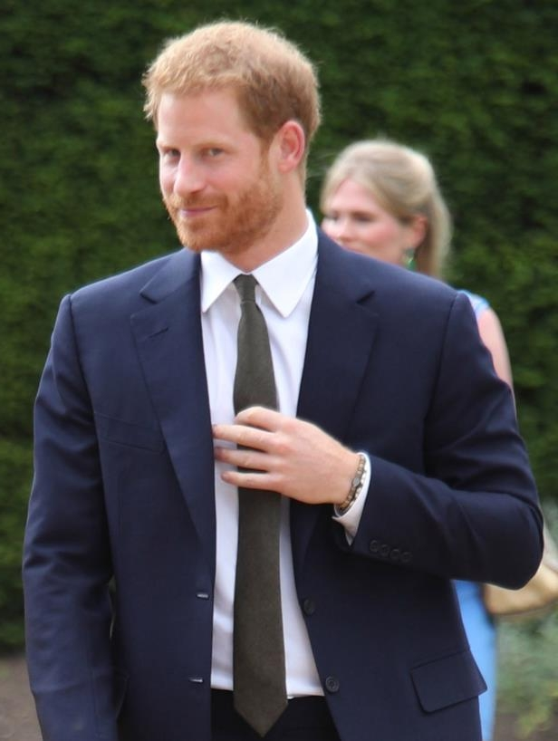 Prince Harry wearing a suit and tie: Prince Harry arrives at the Your Commonwealth Youth Challenge reception at Marlborough House in London on July 5, 2018.