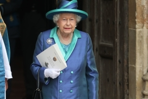 Quick on one's feet! The Queen, 92, almost stumbles on the steps of Westminster Abbey as she leaves RAF centenary service - but immediately regains her balance