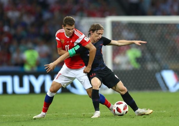 Slide 1 of 118: SOCHI, RUSSIA - JULY 07:  Luka Modric of Croatia is challenged by Roman Zobnin of Russia during the 2018 FIFA World Cup Russia Quarter Final match between Russia and Croatia at Fisht Stadium on July 7, 2018 in Sochi, Russia.  (Photo by Lars Baron - FIFA/FIFA via Getty Images)