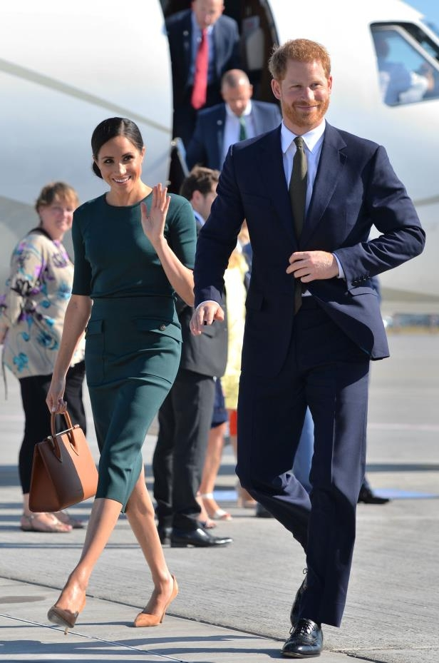 Slide 1 of 9: Britain's Prince Harry and his wife Meghan, the Duke and Duchess of Sussex, arrive at Dublin City Airport for a two-day visit to Dublin, Ireland July 10, 2018.  Dominic Lipinski/Pool via REUTERS