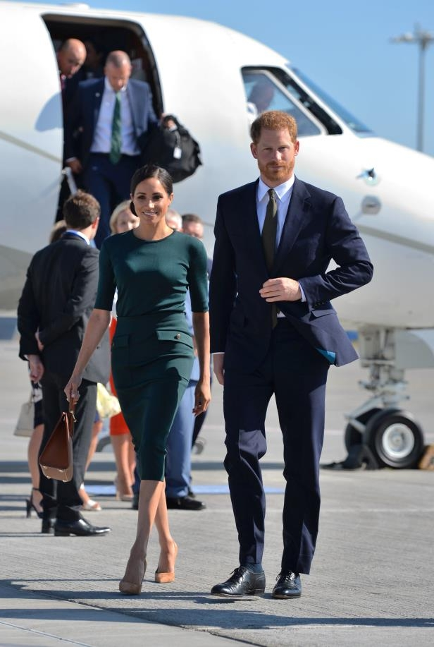 Slide 2 of 9: Britain's Prince Harry and his wife Meghan, the Duke and Duchess of Sussex, arrive at Dublin City Airport for a two-day visit to Dublin, Ireland July 10, 2018.  Dominic Lipinski/Pool via REUTERS