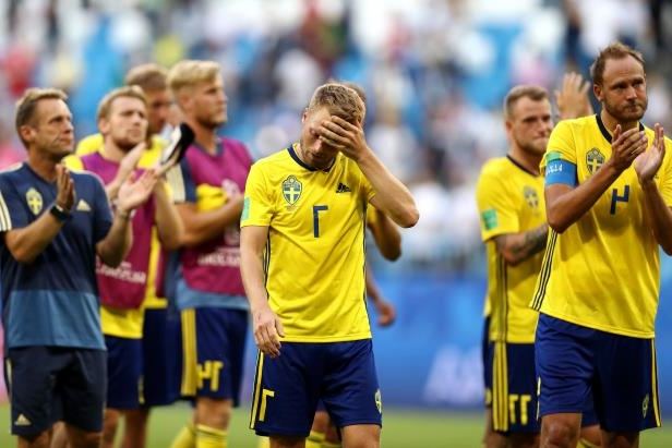 Slide 3 of 118: SAMARA, RUSSIA - JULY 07:  Sebastian Larsson of Sweden looks dejected following his sides defeat in the 2018 FIFA World Cup Russia Quarter Final match between Sweden and England at Samara Arena on July 7, 2018 in Samara, Russia.  (Photo by Ryan Pierse/Getty Images)