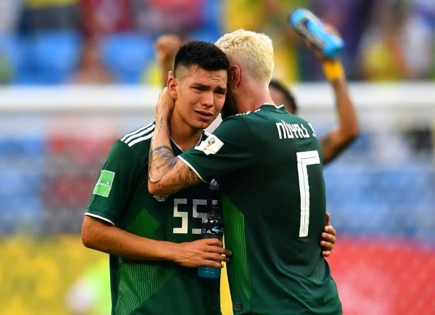Slide 31 of 118: Soccer Football - World Cup - Round of 16 - Brazil vs Mexico - Samara Arena, Samara, Russia - July 2, 2018  Mexico's Hirving Lozano and Miguel Layun look dejected after the match   REUTERS/Dylan Martinez     TPX IMAGES OF THE DAY