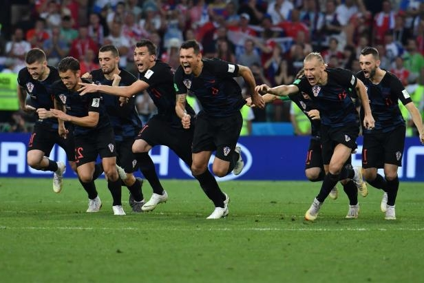 Slide 4 of 118: Croatia's players celebrate their winning penalty during the Russia 2018 World Cup quarter-final football match between Russia and Croatia at the Fisht Stadium in Sochi on July 7, 2018. (Photo by Nelson Almeida / AFP) / RESTRICTED TO EDITORIAL USE - NO MOBILE PUSH ALERTS/DOWNLOADS        (Photo credit should read NELSON ALMEIDA/AFP/Getty Images)