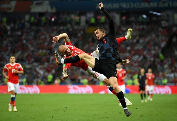 Slide 5 of 118: SOCHI, RUSSIA - JULY 07:  Mateo Kovacic of Croatia clashes with Fedor Kudriashov of Russia during the 2018 FIFA World Cup Russia Quarter Final match between Russia and Croatia at Fisht Stadium on July 7, 2018 in Sochi, Russia.  (Photo by Shaun Botterill/Getty Images)
