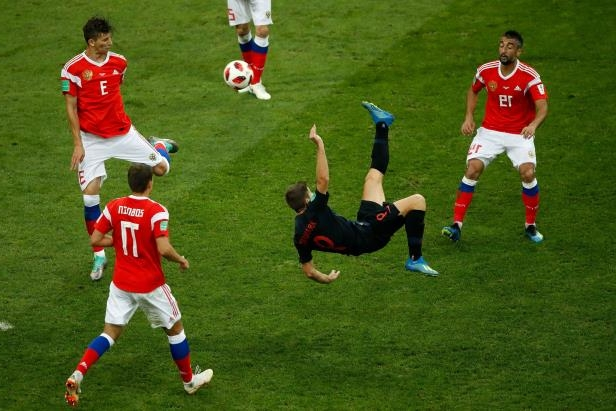 Slide 6 of 118: TOPSHOT - Croatia's forward Andrej Kramaric (C) kicks the ball during the Russia 2018 World Cup quarter-final football match between Russia and Croatia at the Fisht Stadium in Sochi on July 7, 2018. (Photo by Odd ANDERSEN / AFP) / RESTRICTED TO EDITORIAL USE - NO MOBILE PUSH ALERTS/DOWNLOADS        (Photo credit should read ODD ANDERSEN/AFP/Getty Images)