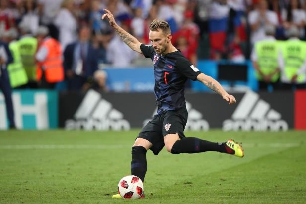Slide 7 of 118: SOCHI, RUSSIA - JULY 07:   Ivan Rakitic of Croatia scores  the winning penalty in a shootout during the 2018 FIFA World Cup Russia Quarter Final match between Russia and Croatia at Fisht Stadium on July 7, 2018 in Sochi, Russia. (Photo by Matthew Ashton - AMA/Getty Images)