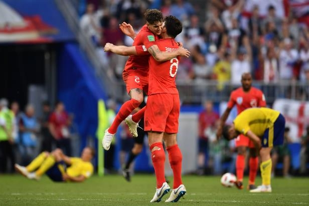 Slide 8 of 118: England's defender Harry Maguire (L) and England's defender John Stones celebrate their victory at the end of the Russia 2018 World Cup quarter-final football match between Sweden and England at the Samara Arena in Samara on July 7, 2018. (Photo by Fabrice COFFRINI / AFP) / RESTRICTED TO EDITORIAL USE - NO MOBILE PUSH ALERTS/DOWNLOADS (Photo credit should read FABRICE COFFRINI/AFP/Getty Images)