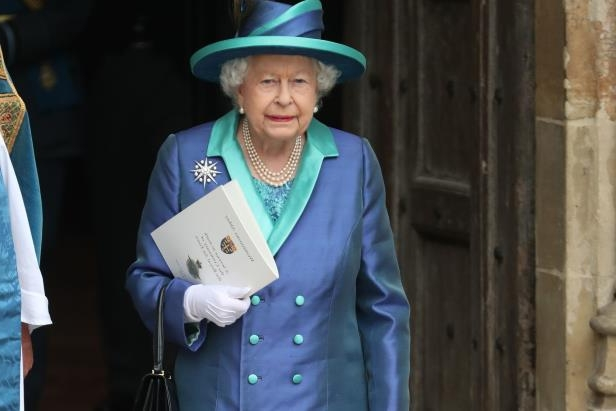 The Queen immediately regained her balance and walked down the steps without any aide