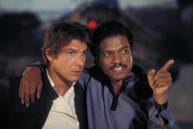 Billy Dee Williams, Harrison Ford posing for the camera: Billy Dee Williams as Lando Calrissian and Harrison Ford as Han Solo in 'Star Wars'.