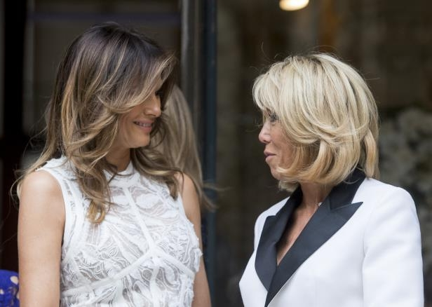 French First lady Brigitte Macron, left, and US First Lady Melania Trump smile ahead of a NATO spouses dinner at Jubilee Museum in Brussels, Belgium, Wednesday, July 11, 2018. NATO leaders gathered in Brussels Wednesday for a two-day summit to discuss Russia, Iraq and their mission in Afghanistan. (Stephanie Lecocq/Pool Photo via AP)