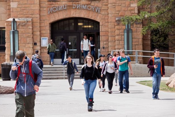 LARAMIE, WY - APRIL 30: Students walk across campus between classes at the University of Wyoming, on April 30, 2018 in Laramie, Wyoming. UW is a land-grant university, founded in March 1886 and opened in September 1887. The University of Wyoming is unusual in that its location within the state is written into the state's constitution. (Photo by Melanie Stetson Freeman/The Christian Science Monitor via Getty Images)