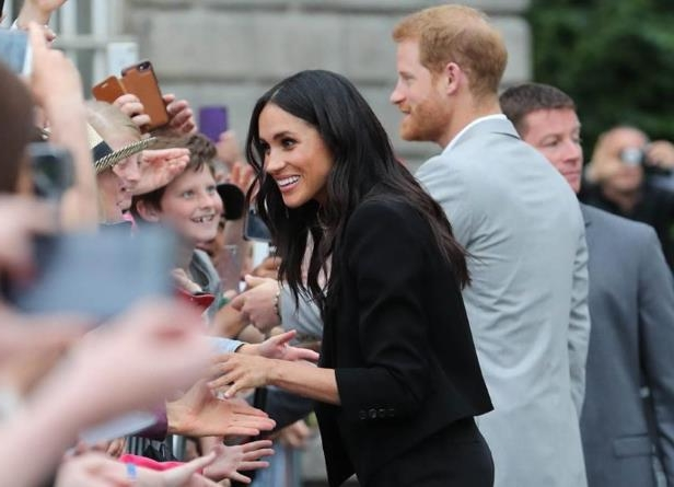 Meghan greets the crowds at Trinity