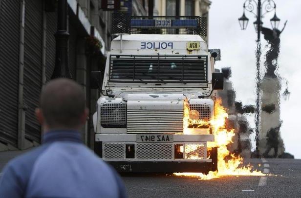 petrol bomb is thrown at a police van as trouble flairs after the Apprentice Boys of Derry parade in Derry in 2015.