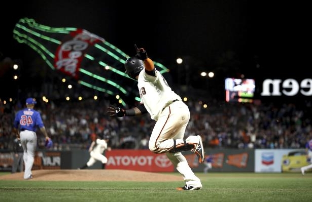 Slide 1 of 75: SAN FRANCISCO, CA - JULY 09:  Pablo Sandoval #48 of the San Francisco Giants runs up the first base line after hitting the game-winning hit in the bottom of the 11th inning against the Chicago Cubs at AT&T Park on July 9, 2018 in San Francisco, California.  (Photo by Ezra Shaw/Getty Images)