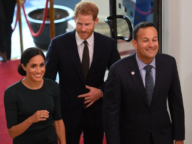 Slide 13 of 14: Britain's Prince Harry and his wife Meghan, the Duke and Duchess of Sussex, are greeted by the Taoiseach Leo Varadkar, as they arrive for a two-day visit to Dublin, Ireland July 10, 2018.  REUTERS/Clodagh Kilcoyne