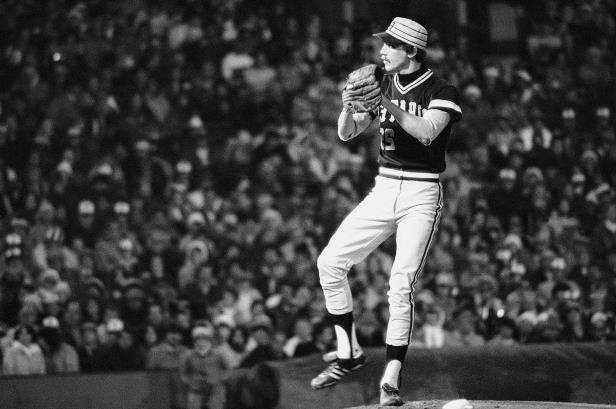 Slide 18 of 63: Pittsburgh Pirate pitcher Bruce Kison delivers to a Baltimore Orioles batter during game 1 of the World Series, Oct. 10, 1979 in Baltimore, Md. The Orioles beat the Pirates 5-4. (AP Photo/Ray Stubblebine)