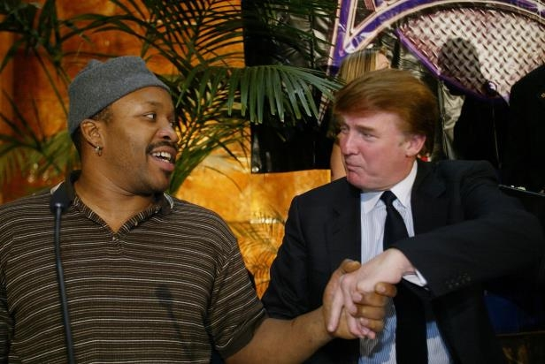 Slide 28 of 28: UNITED STATES - NOVEMBER 05:  Boxer Tim Witherspoon shakes hands with Donald Trump as they seal deal for a heavyweight tournament with eight fighters competing for $100,000 on a Pay-Per-View show from Trump's Taj Mahal in Atlantic City on Nov. 30.