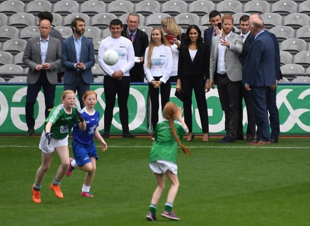 Slide 29 of 86: Britain's Prince Harry and Meghan, the Duchess of Sussex, watch a demonstration of traditional Gaelic sports at Croke Park in Dublin, Ireland, July 11, 2018. REUTERS/Cathal McNaughton