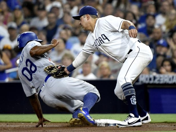 Slide 3 of 75: SAN DIEGO, CA - JULY 9: Andrew Toles #60 of the Los Angeles Dodgers slides into third base ahead of the tag of Christian Villanueva #22 of the San Diego Padres during the eighth inning of a baseball game at PETCO Park on July 9, 2018 in San Diego, California. (Photo by Denis Poroy/Getty Images)