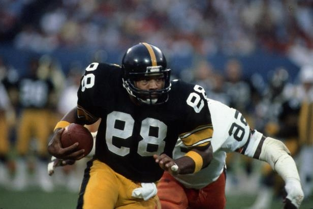 Slide 31 of 63: CLEVELAND - AUGUST 8: Tight end Bennie Cunningham #89 of the Pittsburgh Steelers runs with the football against linebacker Chip Banks #56 of the Cleveland Browns during a preseason game at Municipal Stadium on August 8, 1981 in Cleveland, Ohio. (Photo by George Gojkovich/Getty Images)