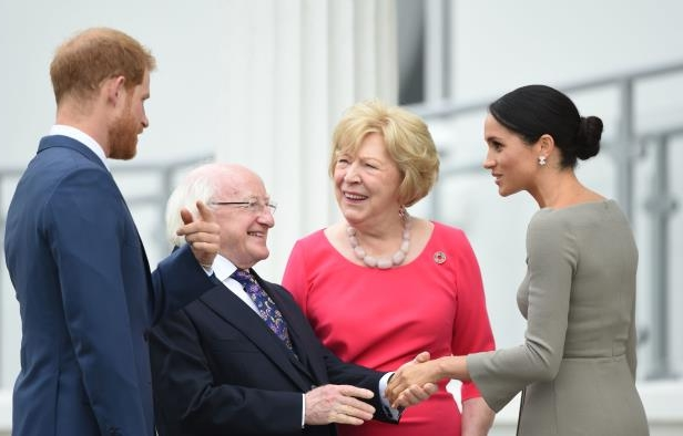 Slide 33 of 86: The Duke and Duchess of Sussex greet President Michael D Higgins and Sabina Higgins, as they arrive at Aras an Uactharain