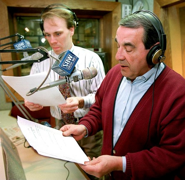 Slide 34 of 63: BRIGHTON, MA - JANUARY 3: Broadcasters Gil Santos and Jay McQuaide alternate reading the long list of school cancelations caused by the snowstorm. (Photo by Frank O'Brien/The Boston Globe via Getty Images)