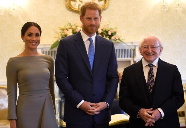 Slide 37 of 86: Britain's Prince Harry and his wife Meghan, Duchess of Sussex, pose for a photograph with Ireland's President, Michael Higgins, on their second day of a two-day visit to Dublin, Ireland July 11, 2018.  REUTERS/Clodagh Kilcoyne