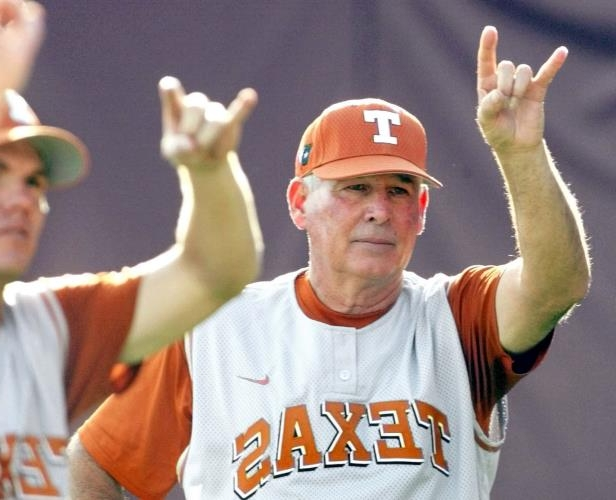Slide 42 of 63: FILE- In this June 8, 2003, file photo, Texas head coach Augie Garrido, left, does a hook 'em horns sign just prior to the first pitch against Florida State in Game one of the NCAA college baseball super regionals in Tallahassee, Fla. Garrido, who won three national baseball championships at Cal State Fullerton and two more at Texas, has died, the University of Texas announced Thursday, March 15, 2018. He was 79.