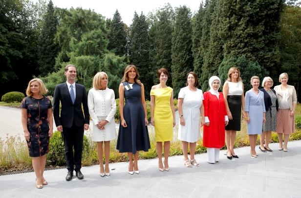 Slide 5 of 9: U.S. first lady Melania Trump and France's first lady Brigitte Macron, Sweden Prime Minister's spouse Ulla Lofven, Belgian Prime Minister's partner Amelie Derbaudrenghien, Slovenian Prime Minister Miro Cerar's partner, Mojca Stropnik, Bulgarian President Rumen Radev's partner Desislava Radeva, Turkey's first lady Emine Erdogan, Jens Stoltenberg's spouse Ingrid Schulerud, European Council President Donald Tusk's wife Malgorzata Sochacka, and Luxemburg's Prime Minister Xavier Bettel's husband, Gauthier Destenay, pose for a picture after attending a concert at the Queen Elisabeth Music Chapel in Waterloo, Belgium on July 11.