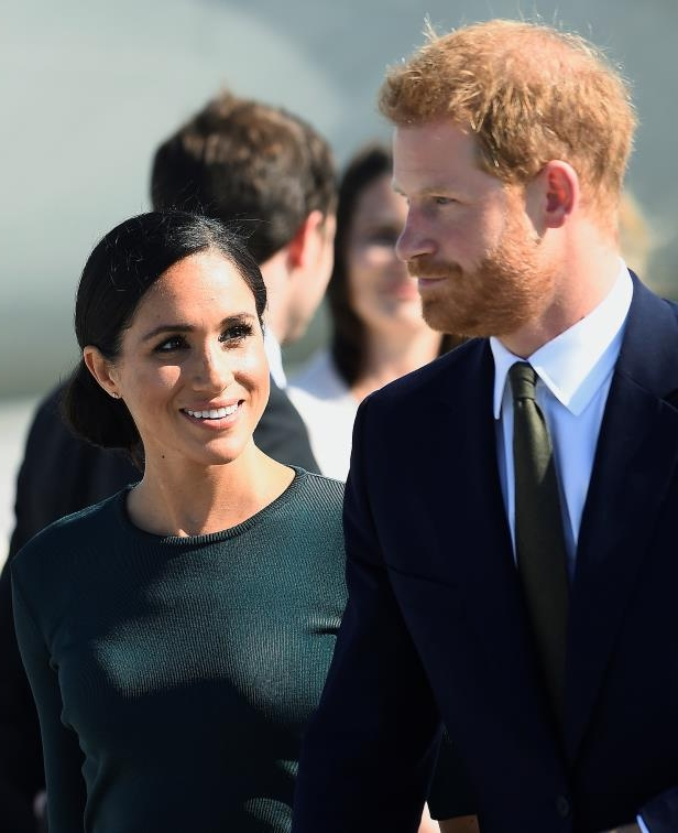 Slide 7 of 14: Britain's Prince Harry and his wife Meghan, the Duke and Duchess of Sussex, arrive at the airport for a two-day visit to Dublin, Ireland July 10, 2018.  REUTERS/Cathal McNaughton