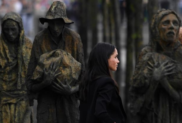 Slide 79 of 86: Meghan Markle, the Duchess of Sussex, visit the Famine Memorial in Dublin, Ireland, July 11, 2018. REUTERS/Cathal McNaughton