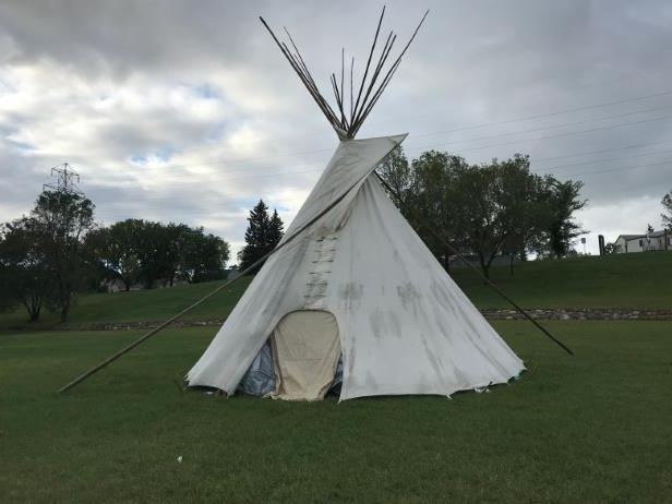 The first teepee in Saskatoon's Healing Camp For Justice was set up Tuesday night.