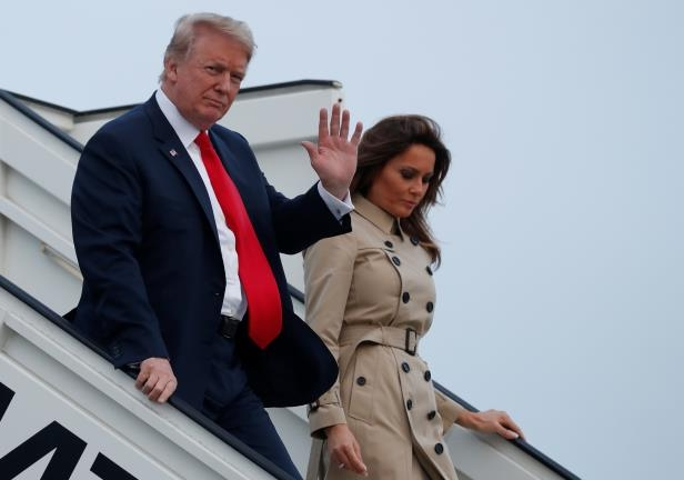 U.S. President Donald Trump and first lady Melania Trump arrive aboard Air Force One ahead of the NATO Summit, at Brussels Military Airport in Melsbroek, Belgium July 10, 2018. REUTERS/Kevin Lamarque