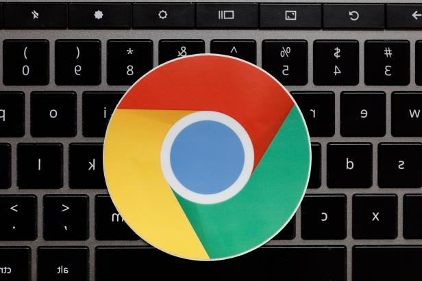 a close up of a keyboard: Google's Chrome browser logo