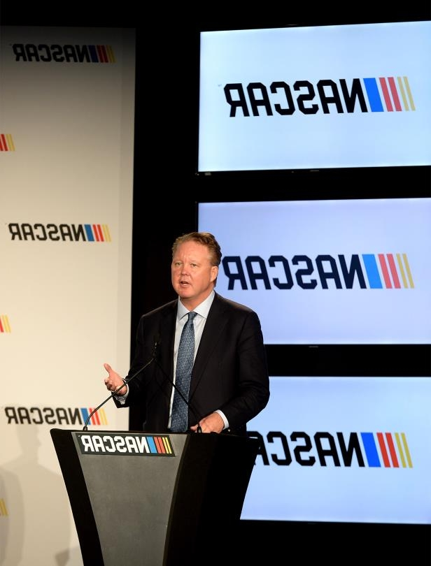 a person in a suit and tie: Brian France, CEO and chairman of NASCAR, gives opening remarks prior to an announcement detailing the enhanced competition format that will be implemented in all three of its national series -- the Monster Energy NASCAR Cup Series, the NASCAR XFINITY Series and the NASCAR Camping World Truck Series -- on Monday, Jan. 23, 2017 at the Charlotte Convention Center in uptown Charlotte, N.C.