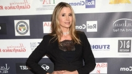 a person posing for a picture: Mira Sorvino has revealed she was gagged with a condom when she was just 16 at her first ever audition for a horror film.