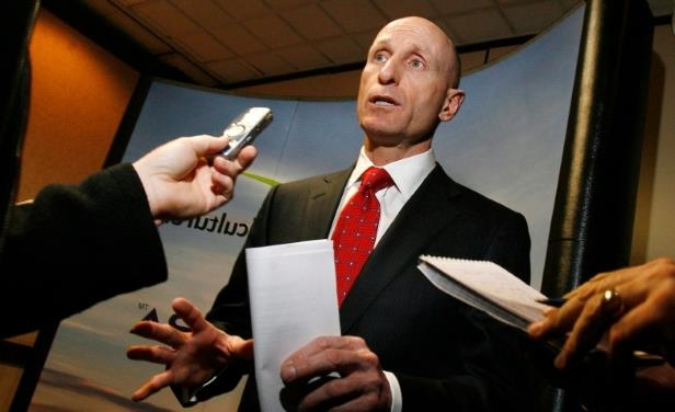 a person wearing a suit and tie: Hydro One's CEO Mayo Schmidt has retired as part of an agreement between the Ontario government and the utility company.