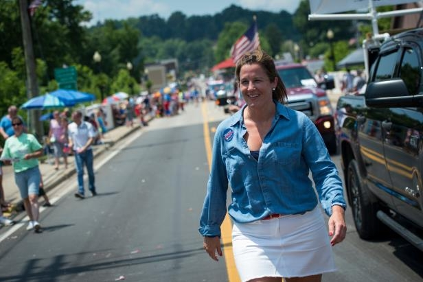 Democrat Talley Sergent, who is running against GOP Rep. Alex X. Mooney in West Virginia's 2nd District, marches in a July Fourth parade in Ripley, W.Va., last week. (Sarah Silbiger/CQ Roll Call)