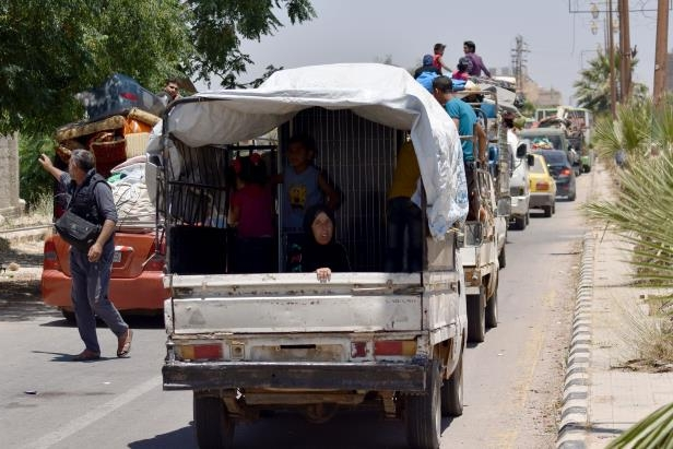 Displaced Syrians from the Daraa province come back to their hometown in Bosra, southwestern Syria, on July 11, 2018.