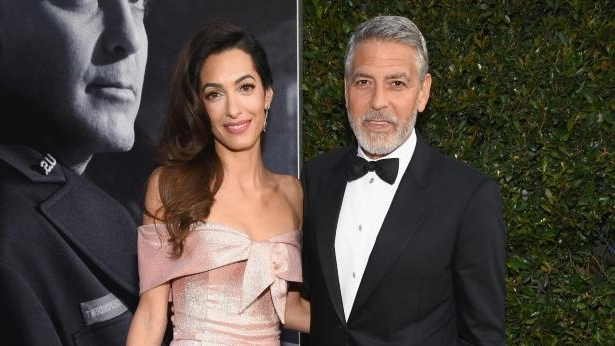 George Clooney, Amal Clooney are posing for a picture