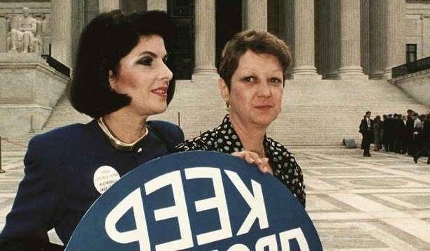 "Gloria Allred (right) and Norma McCorvey (""Jane Roe"") demonstrate at the Supreme Court in 1990. McCorvey later became a pro-life activist."