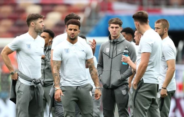 Kyle Walker et al. standing in front of a crowd: Clive Rose/Getty Images Sport
