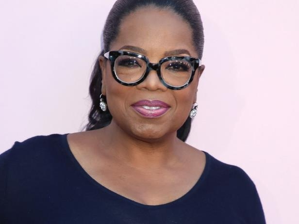 Oprah Winfrey wearing glasses and smiling at the camera: Refinery29