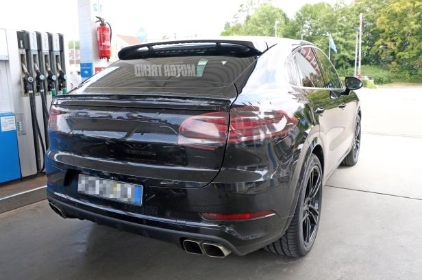 Slide 10 of 15: Porsche-Cayenne-Coupe-rear-view.jpg