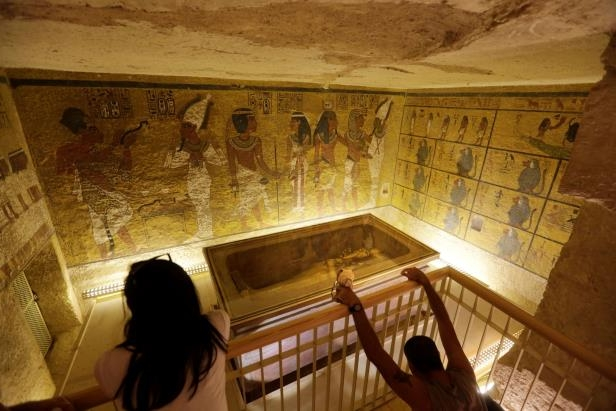 Slide 11 of 18: In this Thursday, Nov. 5, 2015 file photo, tourists look at the tomb of King Tut as it is displayed in a glass case at the Valley of the Kings in Luxor, Egypt. On Saturday, Nov. 28, 2015, Egyptian Antiquities Minister Mamdouh el-Damaty said there is a 90 percent chance that hidden chambers will be found within King Tutankhamun's tomb, based on the preliminary results of a new exploration of the 3,300-year-old mausoleum. (AP Photo/Amr Nabil, File)